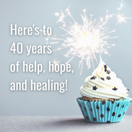 Heres to 40 years of help hope and healing. Graphic with blue cupcake and candle. No logo.