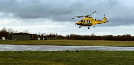 air ambulance flying in field