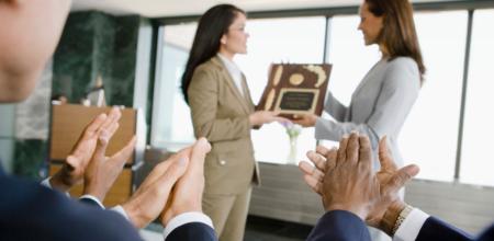 Professional women receiving awards