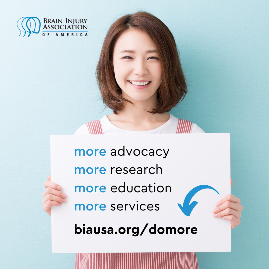 person holding sign that says more advocacy more research more education more services. biausa.org slash donate. BIAA logo top left.