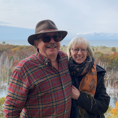BIAA Champion Lance Trexler pictured with wife Laura Trexler with mountains and trees in the background